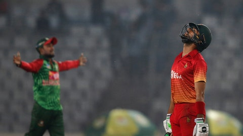 Zimbabwe's Sikandar Raza, right, reacts after his team captain Graeme Cremer dismissed by Bangladesh's Rubel Hossain during the Tri-Nation one-day international cricket series in Dhaka, Bangladesh, Tuesday, Jan. 23, 2018. (AP Photo/A.M. Ahad)