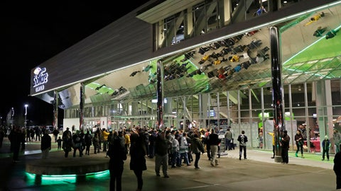 In this Jan. 9, 2018, photo, fans arrive at the ShoWare Center in Kent, Wash., about 20 miles south of Seattle, for a Western Hockey League game between the Seattle Thunderbirds and the Portland Winterhawks. Hockey's history in Seattle dates back more than a century to when the Seattle Metropolitans hoisted the 1917 Stanley Cup, and all indications are that an NHL franchise could arrive sometime after 2020, depending on construction of a remodeled Seattle Center arena. (AP Photo/Ted S. Warren)