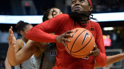 FILE - In this Nov. 19, 2017, file photo, Maryland's Kaila Charles, right, turns to shoot as Connecticut's Gabby Williams, back, defends during the first half an NCAA college basketball game, in Hartford, Conn. Seems as if the three-time Big Ten women's basketball champions aren't ready to hand over the crown. With a team that has very little depth or experience, Maryland again stands along atop the conference. (AP Photo/Jessica Hill, File)