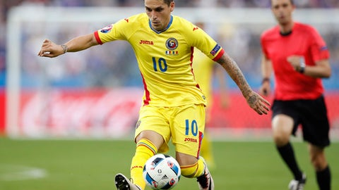 FILE - In this file picture taken on Friday, June 10, 2016, Romania's Nicolae Stanciu goes for the ball during the Euro 2016 Group A soccer match between France and Romania, at the Stade de France, in Saint-Denis, north of Paris. Stanciu has completed a transfer from Anderlecht to Sparta Prague. The Czech club says the 24-year-old Stanciu has signed a contract through the 2020-21 season. (AP Photo/Christophe Ena)