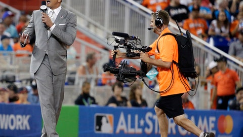 FILE - In this July 11, 2017, file photo, former MLB player Alex Rodriguez reports from the field during the MLB baseball All-Star Game, in Miami. Rodriguez once again is taking over for Aaron Boone in a high-profile spot, this time moving into the ESPN booth for Sunday Night Baseball. ESPN announced Tuesday, Jan. 23, 2018, that A-Rod was joining its crew as an analyst. The former star slugger will become a rare, two-network announcer _ he will continue as a studio analyst for Fox Sports in the postseason.  Rodriguez fills the ESPN spot held last season by Boone, hired last month to manage the New York Yankees. It will mark the second time Rodriguez has followed Boone. (AP Photo/Lynne Sladky, File)