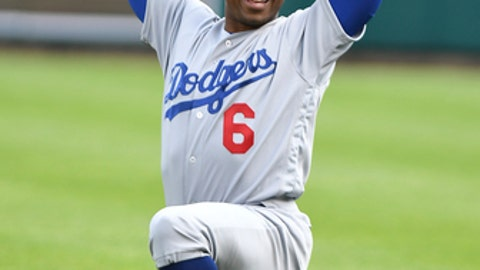 Los Angeles Dodgers Curtis Granderson warms up in the outfield before playing the Detroit Tigers in a baseball game, Saturday, Aug. 19, 2017, in Detroit. Granderson was traded to the Dodgers Friday night. (AP Photo/Lon Horwedel)