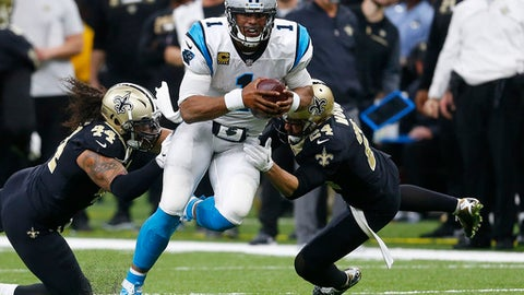 FILE - In this Dec. 3, 2017, file photo, Carolina Panthers quarterback Cam Newton (1) tries to avoid the tackle by New Orleans Saints outside linebacker Hau'oli Kikaha (44) and cornerback Sterling Moore (24) in the second half of an NFL football game in New Orleans. Panthers new offensive coordinator Norv Turner will be in charge of directing quarterback Cam Newton and the Panthers offense next season. (AP Photo/Butch Dill, File)