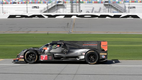 FILE - In this Jan. 5, 2018, file photo, the Penske team Acura DPI heads down pit road during testing for the IMSA 24 hour auto race at Daytona International Speedway in Daytona Beach, Fla. Drivers for the team will be Helio Castroneves, of Brazil, Graham Rahal and Ricky Taylor. (AP Photo/John Raoux, File)
