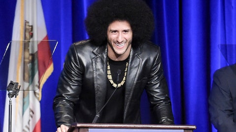 FILE - In this Dec. 3, 2017, file photo, Colin Kaepernick attends the 2017 ACLU SoCal's Bill of Rights Dinner at the Beverly Wilshire Hotel in Beverly Hills, Calif. A visit by former San Francisco 49ers quarterback Colin Kaepernick to New York's Rikers Island jail facility has drawn a rebuke from the union representing city correction officers. The head of the Correction Officers Benevolent Association tells the Daily News that Kaepernick's presence at Rikers on Tuesday, Dec. 12, 2017, will encourage inmates to attack jail guards. (Photo by Richard Shotwell/Invision/AP, File)