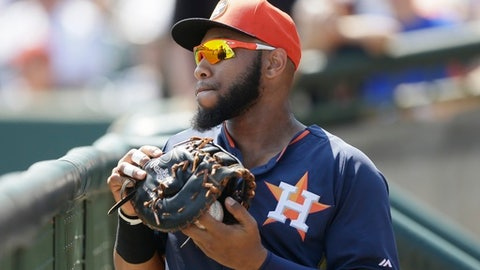 FILE - This March 15, 2015 file photo shows Houston Astros first baseman Jon Singleton in the dugout before the first inning of a spring training exhibition baseball game against the Washington Nationals in Kissimmee, Fla. Singleton has been suspended after testing positive for banned drugs. (AP Photo/Carlos Osorio, file)