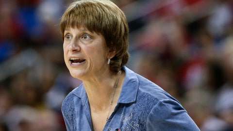 FILE - In this March 22, 2014, file photo, Nebraska coach Connie Yori watches during the team's first-round NCAA college basketball tournament game against Fresno State in Los Angeles. Yori is returning to women's basketball as a member of the Creighton staff. Yori, who starred at Creighton as a player and was the Bluejays' coach from 1992-2002, will be a program adviser. Coach Jim Flanery said Tuesday she would help develop game strategy, scout opponents and participate in on-campus recruiting. (AP Photo/Jae C. Hong, File)