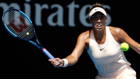United States' Madison Keys makes a forehand return to Germany's Angelique Kerber during their quarterfinal at the Australian Open tennis championships in Melbourne, Australia, Wednesday, Jan. 24, 2018. (AP Photo/Ng Han Guan)