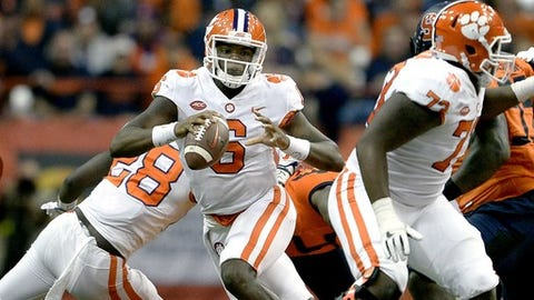 Clemson quarterback Zerrick Cooper (6) scrambles out of the pocket during the second half of an NCAA college football game against Syracuse, Friday, Oct. 13, 2017, in Syracuse, N.Y. Syracuse upset Clemson 27-24. (AP Photo/Adrian Kraus)