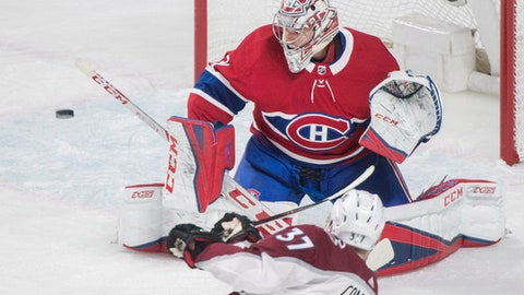 Montreal Canadiens goaltender Carey Price  makes a save against Colorado Avalanche left wing J.T. Compher (37) during the first period of an NHL hockey game Tuesday, Jan. 23, 2018, in Montreal. (Graham Hughes/The Canadian Press via AP)