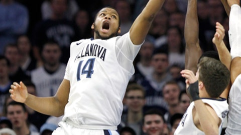 Villanova forward Omari Spellman (14) reaches for a rebound during the second half of an NCAA college basketball game against Providence, Tuesday, Jan. 23, 2018, in Philadelphia. Villanova won 89-69. (AP Photo/Laurence Kesterson)
