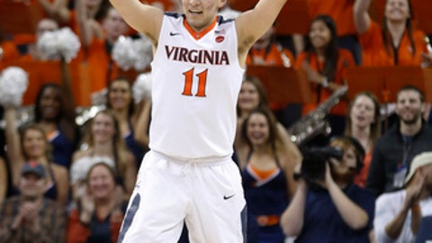 Virginia guard Ty Jerome celebrates a basket during the second half of the team's NCAA college basketball game against Clemson in Charlottesville, Va., Tuesday, Jan. 23, 2018. Virginia won 61-36. (AP Photo/Steve Helber)