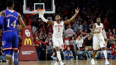 Oklahoma's Rashard Odomes (1) reacts as Khadeem Lattin (3) and Kansas's Malik Newman (14) look on during the second half of an NCAA college basketball game in Norman, Okla., Tuesday, Jan. 23, 2018. (AP Photo/Garett Fisbeck)