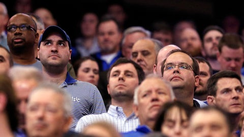 Fans observe a moment of silence to honor shooting victims at Marshall County Kentucky's High School before an NCAA college basketball game between Kentucky and Mississippi State, Tuesday, Jan. 23, 2018, in Lexington, Ky. (AP Photo/James Crisp)