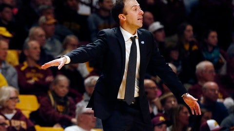 Minnesota coach Richard Pitino watches during the second half of the team's NCAA college basketball game against Northwestern on Tuesday, Jan. 23, 2018, in Minneapolis. Northwestern won 77-69. (AP Photo/Jim Mone)