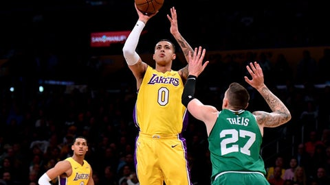 LOS ANGELES, CA - JANUARY 23:  Kyle Kuzma #0 of the Los Angeles Lakers scores on a jumper over Daniel Theis #27 of the Boston Celtics during the first half at Staples Center on January 23, 2018 in Los Angeles, California.  (Photo by Harry How/Getty Images)