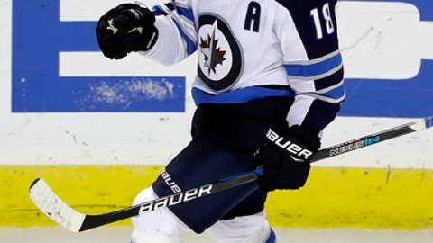 Winnipeg Jets' Bryan Little celebrates after scoring in overtime of the team's NHL hockey game against the San Jose Sharks on Tuesday, Jan. 23, 2018, in San Jose, Calif. Winnipeg won 5-4. (AP Photo/Marcio Jose Sanchez)