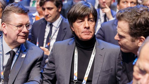 Joachim Loew, center,  head coach of the German national soccer team, attends the soccer UEFA Nations League draw, at the SwissTech Convention Center, in Lausanne, Switzerland, Wednesday, Jan. 24, 2018. (Salvatore Di Nolfi/Keystone via AP)