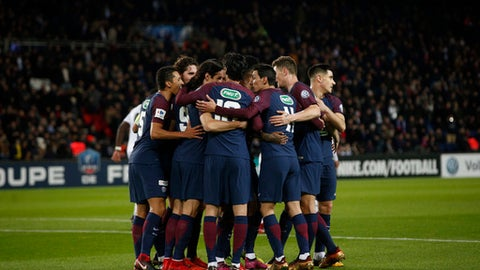 PSG's soccer team celebrate after scoring their side's second goal during the French Cup soccer match, between Paris Saint-Germain and Guingamp at the Parc des Princes Stadium, in Paris, France, Wednesday, Jan. 24, 2018. (AP Photo/Thibault Camus)