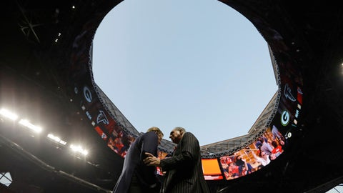 """FILE - In this Sept. 17, 2017, file photo, NFL Commissioner Roger Goodell, left, speaks with Atlanta Falcons owner Arthur Blank under the open roof, before an NFL football game between the Falcons and the Green Bay Packers in Atlanta. TheFalcons are expecting the retractable roof to be """"fully operational"""" for the 2018 season and next year's Super Bowl. Falcons president and CEO Rich McKay told The Associated Press on Wednesday, Jan. 24, 2018, he expects fixes on the roof by the 2018 season """"if not well before."""" Problems kept the roof closed on the $1.5 billion stadium for most of the 2017 season. The unique roof, designed to open like a camera lens, was open only for the Falcons' first home regular-season game. (AP Photo/David Goldman, File)"""