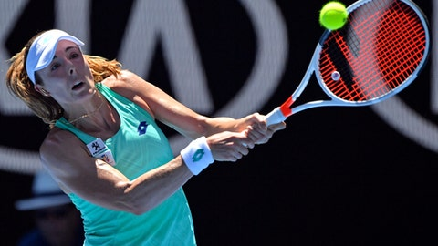 FILE - In this Jan. 19, 2018 file photo France's Alize Cornet makes a backhand return to Belgium's Elise Mertens during their third round match at the Australian Open tennis championships in Melbourne, Australia. Cornet has been dropped from France's Fed Cup team for next month's tie against Belgium after missing three out-of-competition doping tests in the past year.(AP Photo/Andy Brownbill,File)