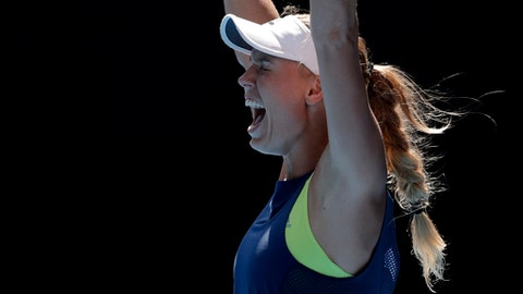 Denmark's Caroline Wozniacki celebrates after defeating Belgium's Elise Mertens in their semifinal at the Australian Open tennis championships in Melbourne, Australia, Thursday, Jan. 25, 2018. (AP Photo/Vincent Thian)