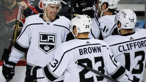 Los Angeles Kings left wing Tanner Pearson (70) celebrates his overtime goal with teammates in an NHL hockey game against the Calgary Flames on Wednesday, Jan. 24, 2018, in Calgary, Alberta. (Jeff McIntosh/The Canadian Press via AP)