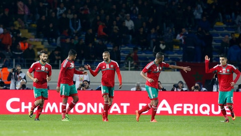 """FILE - In this Saturday, Jan. 13, 2018 file photo, Morocco's team celebrates after scoring against Mauritania during the CHAN (African Nations Championship) opening group A soccer match in Casablanca, Morocco.Morocco is focusing on presenting a clean bid for the 2026 World Cup against North America. The country is saddled by its own baggage: bribery allegations against past World Cup bids that were leveled by U.S. prosecutors in the sprawling investigation into soccer corruption. """"We do not have anything to do with the past as Morocco,"""" 2026 bid chief executive Hicham El Amrani said in an interview with The Associated Press on Thursday, Jan. 25, 2018. """"Do not make me comment on past bids for which we were not part of. Our bid is clean and will be compliant and this is what counts.""""  (AP Photo/Abdeljalil Bounhar, file)"""