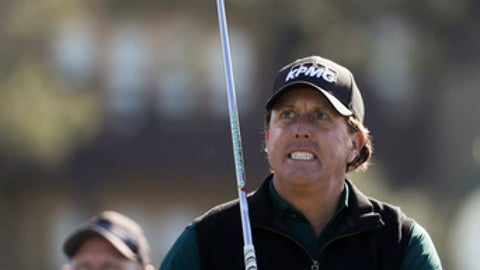 Phil Mickelson grimaces after hitting his tee shot on the 13th hole hole of the North Course at Torrey Pines Golf Course during the first round of the Farmers Insurance Open golf tournament Thursday, Jan. 25, 2018, in San Diego. (AP Photo/Chris Carlson)