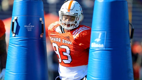 FILE - In this Tuesday, Jan. 23, 2018, file photo, South Squad defensive end Marcus Davenport, of UTSA, runs drills during the South's practice in Mobile, Ala., for Saturday's Senior Bowl NCAA college football game. The 6-foot-6, 259-pounder is one of the top NFL prospects at the Senior Bowl this week, rated as a potential first-rounder and maybe even a Top 10 pick. (AP Photo/Butch Dill)
