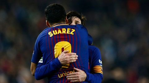 FC Barcelona's Lionel Messi embraces teammate Luis Suarez at the end of the match during the Spanish Copa del Rey, quarter final, second leg, soccer match between FC Barcelona and Espanyol at the Camp Nou stadium in Barcelona, Spain, Thursday, Jan. 25, 2018. (AP Photo/Manu Fernandez)