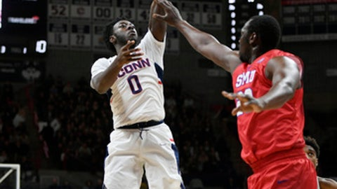 Connecticut's Antwoine Anderson shoots over SMU's Akoy Agau during the first half of an NCAA college basketball game, Thursday, Jan. 25, 2018, in Storrs, Conn. (AP Photo/Jessica Hill)