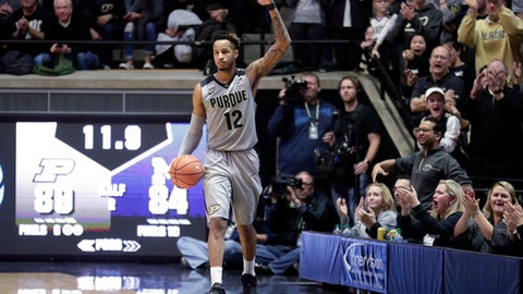 Purdue forward Vincent Edwards (12) celebrates in the final seconds of the team's NCAA college basketball game against Michigan in West Lafayette, Ind., Thursday, Jan. 25, 2018. Purdue defeated Michigan 92-88. (AP Photo/Michael Conroy)