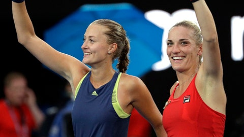 Hungary's Timea Babos, right, and partner France's Kristina Mladenovic celebrate after they defeated Russia's Ekaterina Makarova and Elena Vesnina in the women's doubles final at the Australian Open tennis championships in Melbourne, Australia, Friday, Jan. 26, 2018. (AP Photo/Dita Alangkara)