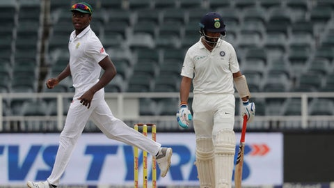 India's batsman Lokesh Rahul right leaves the crease after being dismissed as South Africa's Kagiso Rabada watches on during the third day of the third cricket Test match between South Africa and India at the Wanderers Stadium in Johannesburg