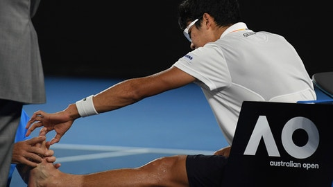 South Korea's Hyeon Chung receives treatment from a trainer during his semifinal against Switzerland's Roger Federer at the Australian Open tennis championships in Melbourne, Australia, Friday, Jan. 26, 2018. (AP Photo/Andy Brownbill)