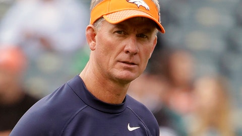 "FILE - In this Nov. 5, 2017, file photo, Denver Broncos' Mike McCoy walks the field before an NFL football game against the Philadelphia Eagles in Philadelphia. The Broncos have fired offensive coordinator Mike McCoy and are replacing him with quarterbacks coach Bill Musgrave. ""I have a responsibility to do what's best for our football team,"" coach Vance Joseph said in a statement ahead of his Monday, Nov. 20, 2017, news conference. ""Although this wasn't an easy decision, we needed to make this change. We have to play a more efficient brand of football offensively as we begin the final stretch of our season.""(AP Photo/Matt Rourke, File)"