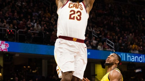 CLEVELAND, OH - JANUARY 26: LeBron James #23 of the Cleveland Cavaliers dunks over Thaddeus Young #21 of the Indiana Pacers during the second half at Quicken Loans Arena on January 26, 2018 in Cleveland, Ohio. The Cavaliers defeated the Pacers 115-108. NOTE TO USER: User expressly acknowledges and agrees that, by downloading and or using this photograph, User is consenting to the terms and conditions of the Getty Images License Agreement. (Photo by Jason Miller/Getty Images)