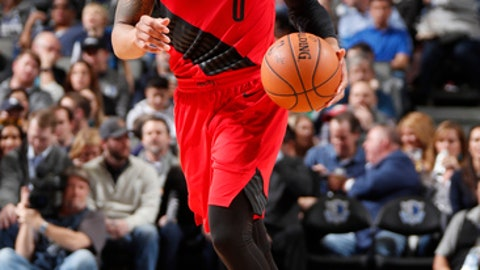 DALLAS, TX - JANUARY 26: Damian Lillard #0 of the Portland Trail Blazers handles the ball against the Dallas Mavericks on January 26, 2018 at the American Airlines Center in Dallas, Texas. NOTE TO USER: User expressly acknowledges and agrees that, by downloading and or using this photograph, User is consenting to the terms and conditions of the Getty Images License Agreement. Mandatory Copyright Notice: Copyright 2018 NBAE (Photo by Danny Bollinger/NBAE via Getty Images)
