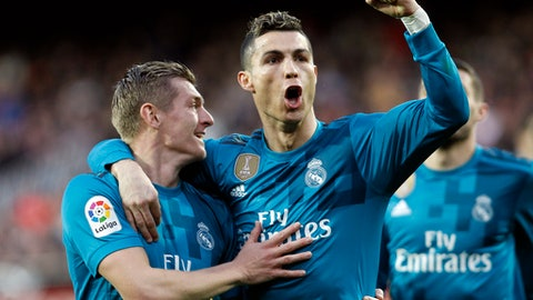Real Madrid's Cristiano Ronaldo, right, and Real Madrid's Toni Kroos, left, celebrates after toni scoring Valencia against during the Spanish La Liga soccer match between Valencia and Real Madrid at the Mestalla stadium in Valencia, Spain, Saturday, Jan. 27, 2018. (AP Photo/Alberto Saiz)