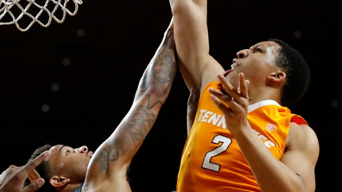 Tennessee forward Grant Williams (2) shoots over Iowa State guard Nick Weiler-Babb, left, during the first half of an NCAA college basketball game, Saturday, Jan. 27, 2018, in Ames, Iowa. (AP Photo/Charlie Neibergall)