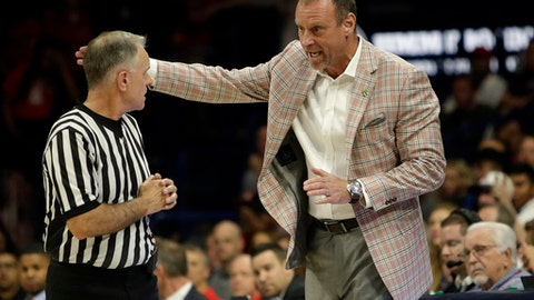 Utah head coach Larry Krystkowiak, right, talks with official Dick Cartmell in the first half during an NCAA college basketball game against Arizona, Saturday, Jan. 27, 2018, in Tucson, Ariz. (AP Photo/Rick Scuteri)