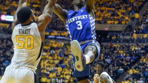 Kentucky guard Hamidou Diallo shoots over West Virginia forward Sagaba Konate during the second half of an NCAA college basketball game Saturday, Jan. 27, 2018, in Morgantown, W.Va. (William Wotring/The Dominion-Post via AP)