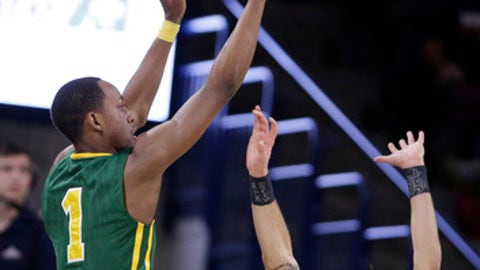 San Francisco guard Jamaree Bouyea (1) shoots over Gonzaga guard Josh Perkins (13) during the first half of an NCAA college basketball game in Spokane, Wash., Saturday, Jan. 27, 2018. (AP Photo/Young Kwak)