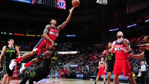 ATLANTA, GA - JANUARY 27:  Bradley Beal #3 of the Washington Wizards dunks against Dennis Schroder #17 of the Atlanta Hawks on January 27, 2018 at Philips Arena in Atlanta, Georgia.  NOTE TO USER: User expressly acknowledges and agrees that, by downloading and/or using this Photograph, user is consenting to the terms and conditions of the Getty Images License Agreement. Mandatory Copyright Notice: Copyright 2018 NBAE (Photo by Scott Cunningham/NBAE via Getty Images)