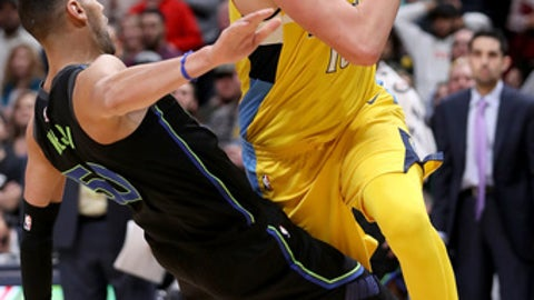 DENVER, CO - JANUARY 27:  Nikola Jokic #15 of the Denver Nuggets makes an offensive foul late in the fourth period against Salah Mejri #50 of the Dallas Mavericks at the Pepsi Center on January 27, 2018 in Denver, Colorado. NOTE TO USER: User expressly acknowledges and agrees that, by downloading and or using this photograph, User is consenting to the terms and conditions of the Getty Images License Agreement.  (Photo by Matthew Stockman/Getty Images)