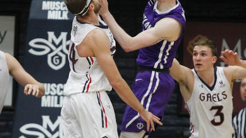 Portland's Josh McSwiggan, right, shoots as Saint Mary's forward Calvin Hermanson defends during the second half of an NCAA college basketball game Saturday, Jan. 27, 2018, in Moraga, Calif. Saint Mary's won 72-55. (AP Photo/George Nikitin)