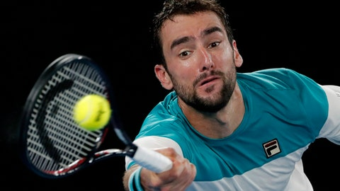 Croatia's Marin Cilic makes a forehand return to Switzerland's Roger Federer during the men's singles final at the Australian Open tennis championships in Melbourne, Australia, Sunday, Jan. 28, 2018. (AP Photo/Vincent Thian)