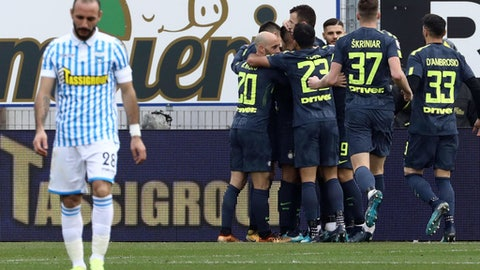 Inter Milan's players celebrate after Spal's Francesco Vicari scored an own goal during a Serie A soccer match between Spal and Inter Milan, at the Paolo Mazza Stadium in Ferrara, northern Italy, Sunday, Jan. 28, 2018. (Serena Campanini/ANSA via AP)