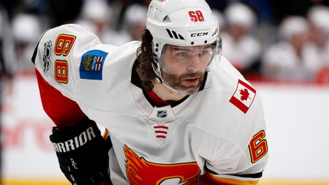 FILE - In this Nov. 25, 2017, file photo, Calgary Flames right wing Jaromir Jagr, of the Czech Republic, waits for a face-off against the Colorado Avalanche during the second period of an NHL hockey game in Denver. Multiple people with direct knowledge of the move say the Calgary Flames have placed Jagr on waivers. The people spoke to The Associated Press on condition of anonymity Sunday, Jan. 28, 2018, because the team had not announced the transaction. (AP Photo/David Zalubowski, File)